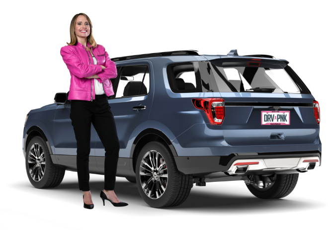 Image of a woman in pink jacket standing next to SUV